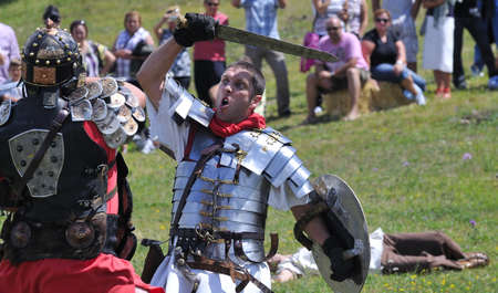 Recreation battle between Romans and barbarians.