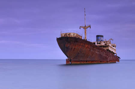 Ship abandoned in the ocean. Stock Photo - 11614668