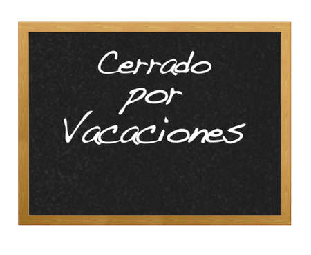 Blackboard with the phrase closed for holidays in Spanish.