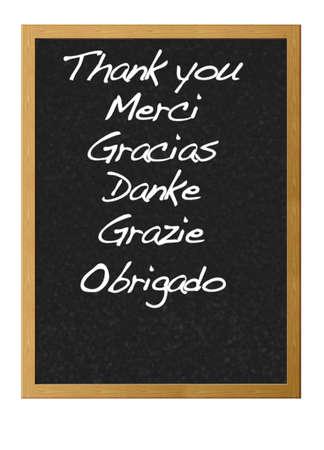 Grazie in diverse lingue scritte su una lavagna.