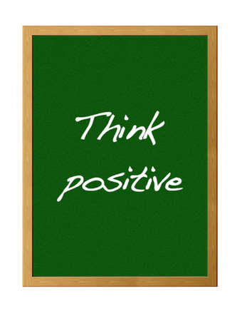 Blackboard with the phrase, Think positive. photo