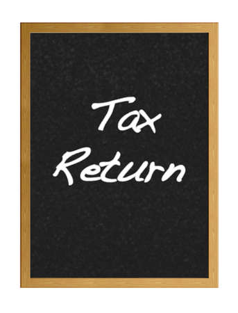 Isolated blackboard with tax return. photo