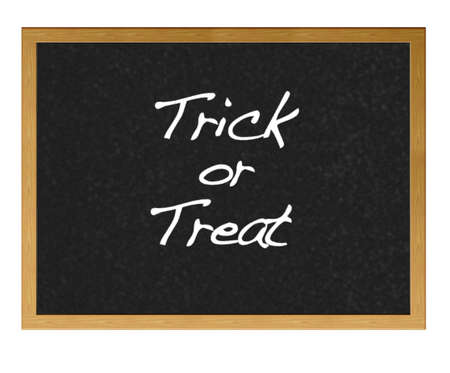 Isolated blackboard. with trick or treat. photo