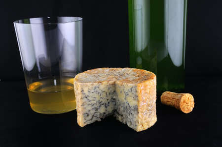 Cabrales cheese and cider on black background. Stock Photo
