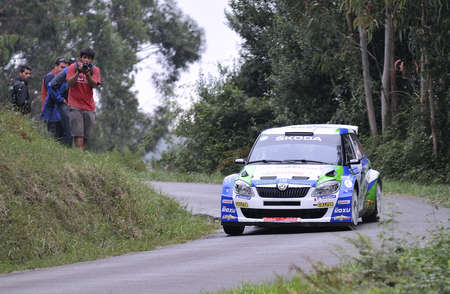 champion of spain: OVIEDO, SPAIN - SEPTEMBER 10: Alberto Hevia drives a Skoda Fabia S2000 car during Prince of Asturias rally championship on September 10, 2011 in Oviedo, Spain.