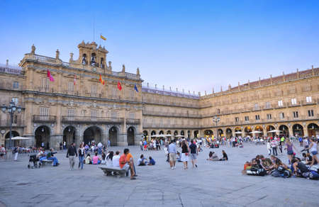 SALAMANCA, SPAIN - AUGUST 2: People sitting in the main square of Salamanca on August 2, 2011 in Salamanca, Spain.