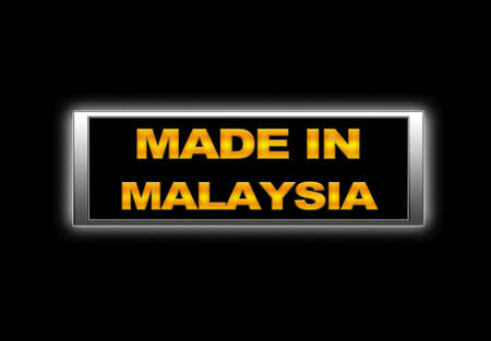 Illuminated sign with Made in Malaysia. photo