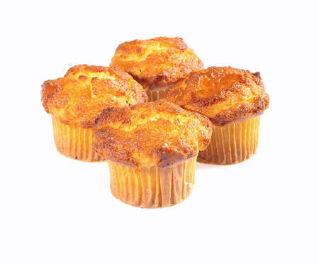 Home made muffins isolated on white background. photo