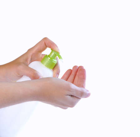 Hands with a bottle moisturizer for the body.