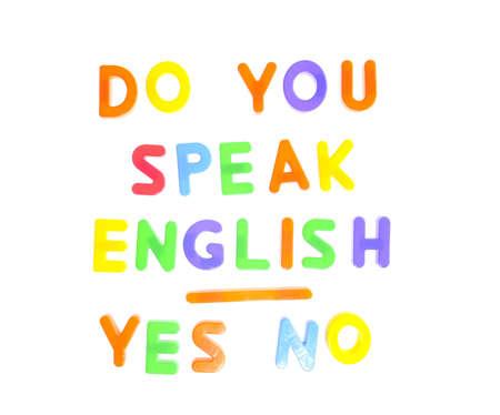 Lei parla inglese scritto in caratteri giocattolo.