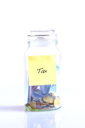 tax tips: Glass jar with tax word isolated on white background