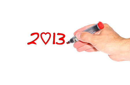 Hand writing the phrase 2013 on white background  Stock Photo - 15390558