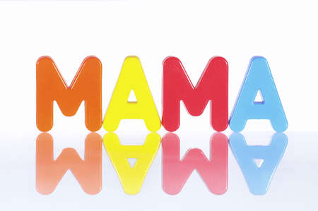 Letters forming the word mom in spanish  Stock Photo - 17365764