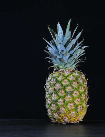 A isolated pineaple on a black background Stock Photo - 17365772