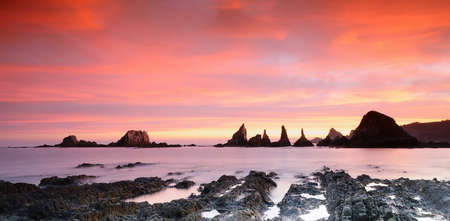Sunrise on Gueirua beach in Asturias, Spain. photo