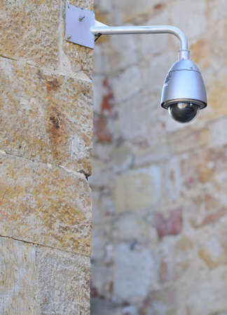 Security camera on street of a city  Stock Photo