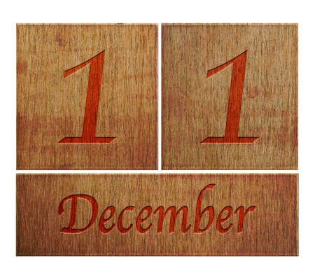december kalender: Illustratie met een houten kalender 11 december Stockfoto