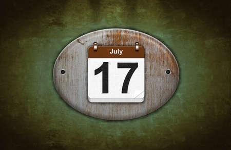 17: Ilustraci�n viejo calendario de madera con 17 de julio