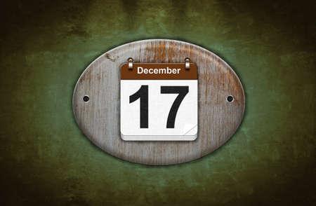 17: Ilustraci�n viejo calendario de madera con 17 de diciembre