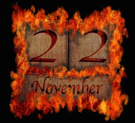 Illustration with a burning wooden calendar November 22