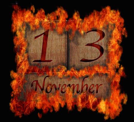 13: Illustration with a burning wooden calendar November 13
