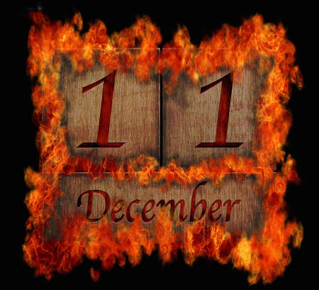 11 number: Illustration with a burning wooden calendar December 11  Stock Photo