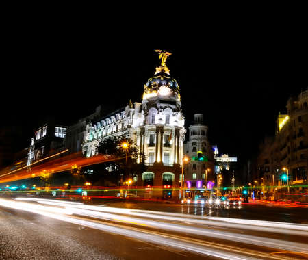 Traffic lights on Gran via street, main shopping street in Madrid at night  Spain, Europe