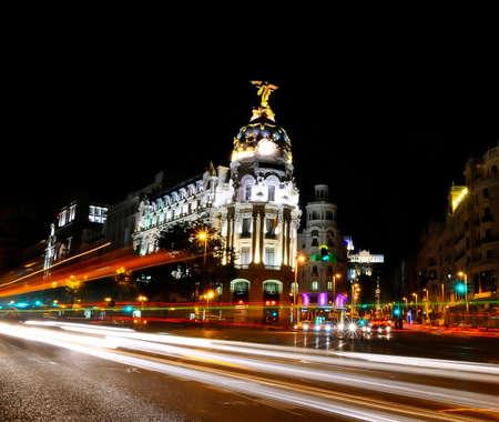 gran via:  Traffic lights on Gran via street, main shopping street in Madrid at night  Spain, Europe