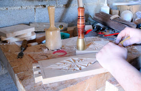 Working with carpenter tools to carve wood  photo