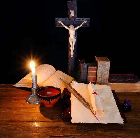 An old book and a crucifix on the table  photo
