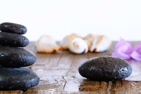thermotherapy: Volcanic hot stones for massage on a table