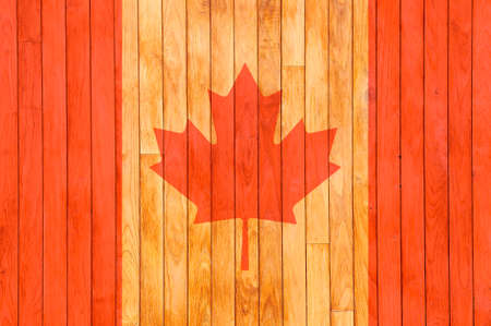 Canada flag background of old wood with knots  Imagens