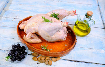 capon: Turkey prepared on the wooden table in the kitchen.