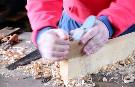 workbench: Carpenter working wood on the workbench carpentry.