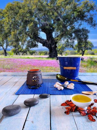 thermotherapy: Wooden table in the sauna area with oils and hot stones. Stock Photo
