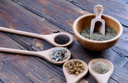 Spices for seasoning in spoons on the table