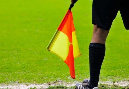 linesman: Assistant referees in action during a soccer match Stock Photo