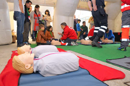 reanimation: POLA DE SIERO SPAIN  MAY 2: Red Cross health teaching a child as cardiopulmonary reanimation in April 2 2015 in Pola de Siero Spain Editorial