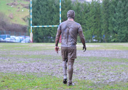 rugby: Detail muddy boots in a rugby match. Stock Photo