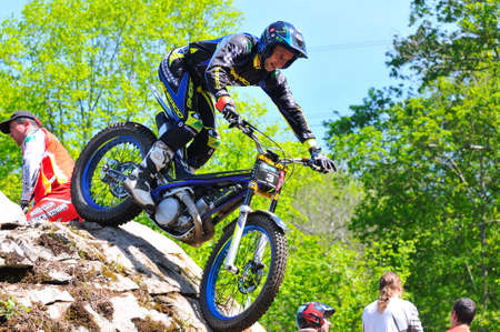 spain championship: EL Condao, SPAIN - MAY 10: Trial Spain Championship on May 10, 2015 in El Condao, Spain. Albert Cabestany descending on rocks.