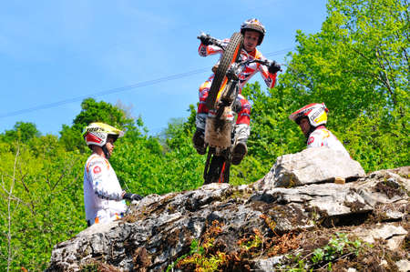 repsol honda: EL Condao, SPAIN - MAY 10: Trial Spain Championship on May 10, 2015 in El Condao, Spain. Moment when Toni Bou is ready to jump over granite rocks.