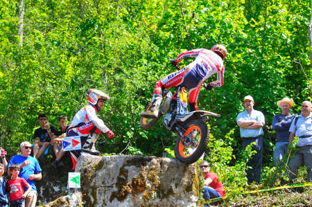 repsol honda: EL Condao, SPAIN - MAY 10: Trial Spain Championship on May 10, 2015 in El Condao, Spain. Moment when Toni Bou jump over granite rocks.