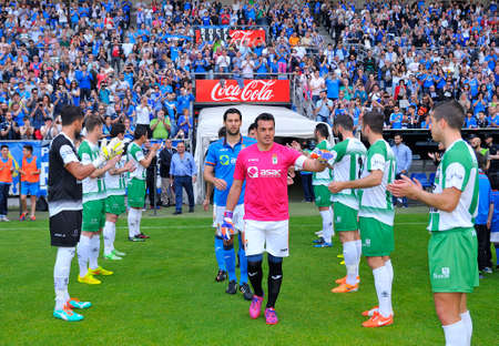 applaud: OVIEDO SPAIN  MAY 10: Football match between Real Oviedo and Somozas in the Carlos Tartiere stadium in May 10 2015 in Oviedo Spain. Players of the Somozas applaud the Real Oviedo for being first in qualifying.