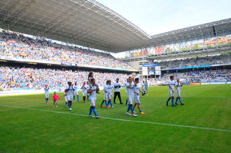 carlos: OVIEDO SPAIN  MAY 10: Football match between Real Oviedo and Somozas in the Carlos Tartiere stadium in May 10 2015 in Oviedo Spain. Real Oviedo players greet supporters after the game.