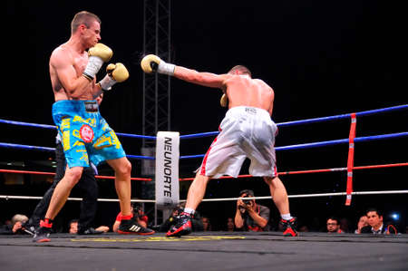 diamante: OVIEDO, SPAIN - MAY 16: Aitor Nieto of Spain beat Estonian Pavel Mamontov by decision to win the European IBF and USBA welterweight championship in May 16, 2015 in Oviedo, Spain. A moment of boxing match between the Spanish Aitor El Diamante Nieto (L) a