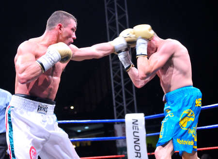 OVIEDO SPAIN  MAY 16: Aitor Nieto of Spain beat Estonian Pavel Mamontov by decision to win the European IBF and USBA welterweight championship in May 16 2015 in Oviedo Spain. Aitor Nieto L tries to beat the Estonian Pavel Mamontov R.