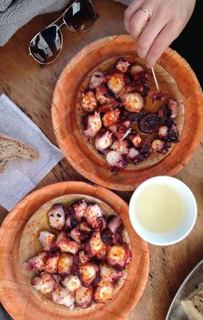 galician: Octopus prepared Galician style, Pulpo a feira. Stock Photo