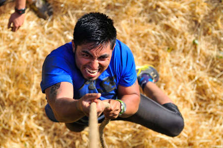 LEON, SPAIN - JUNE 6: Farinato Race, extreme obstacle race in June 6, 2015 in Leon, Spain. People jumping, crawling,passing under a barbed wires or climbing obstacles during extreme obstacle race. Editorial