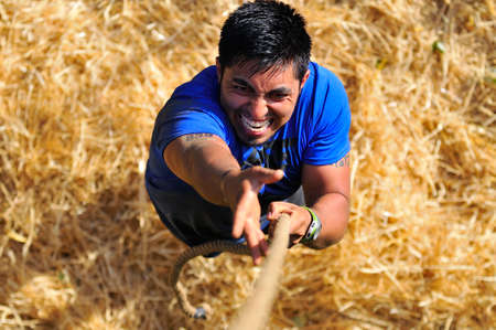 barbed wires: LEON, SPAIN - JUNE 6: Farinato Race, extreme obstacle race in June 6, 2015 in Leon, Spain. People jumping, crawling,passing under a barbed wires or climbing obstacles during extreme obstacle race. Editorial