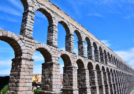 acueducto: The famous ancient aqueduct in Segovia, Castilla y Leon, Spain Stock Photo